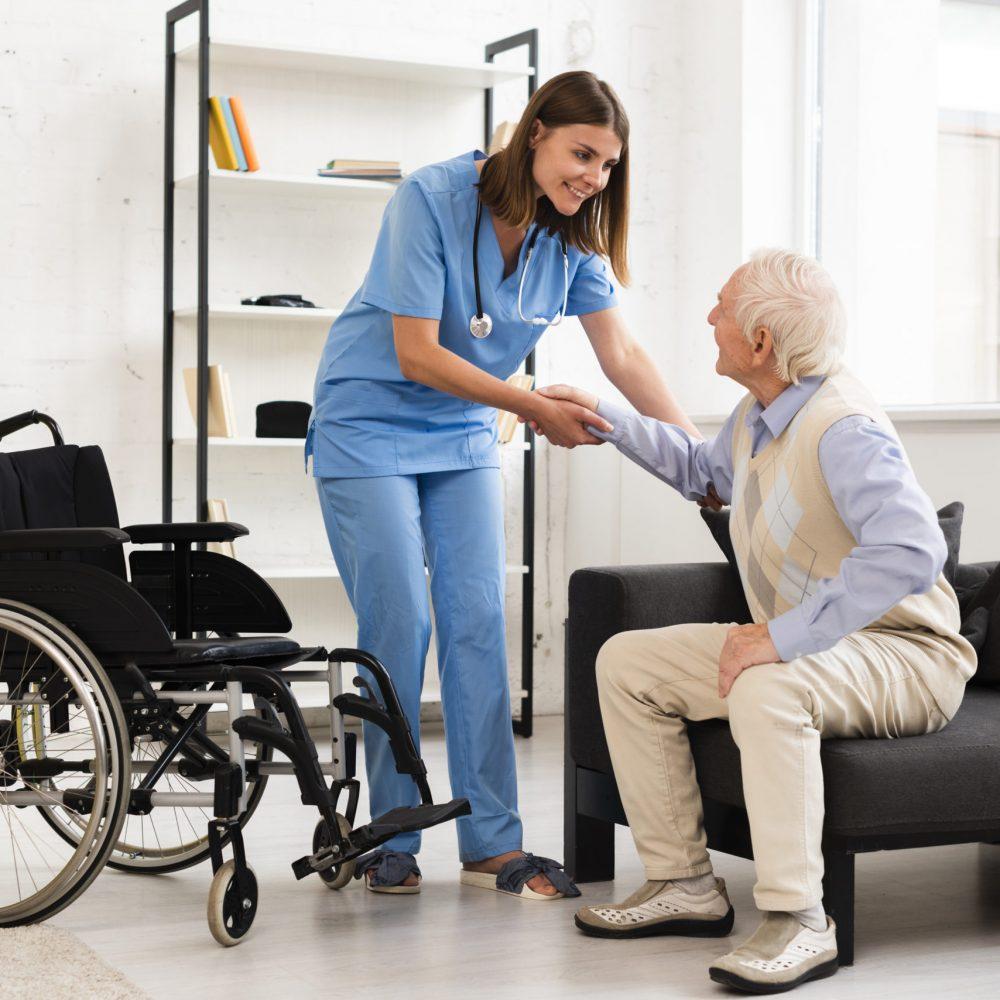 long-shot-nurse-helping-old-man-getting-up